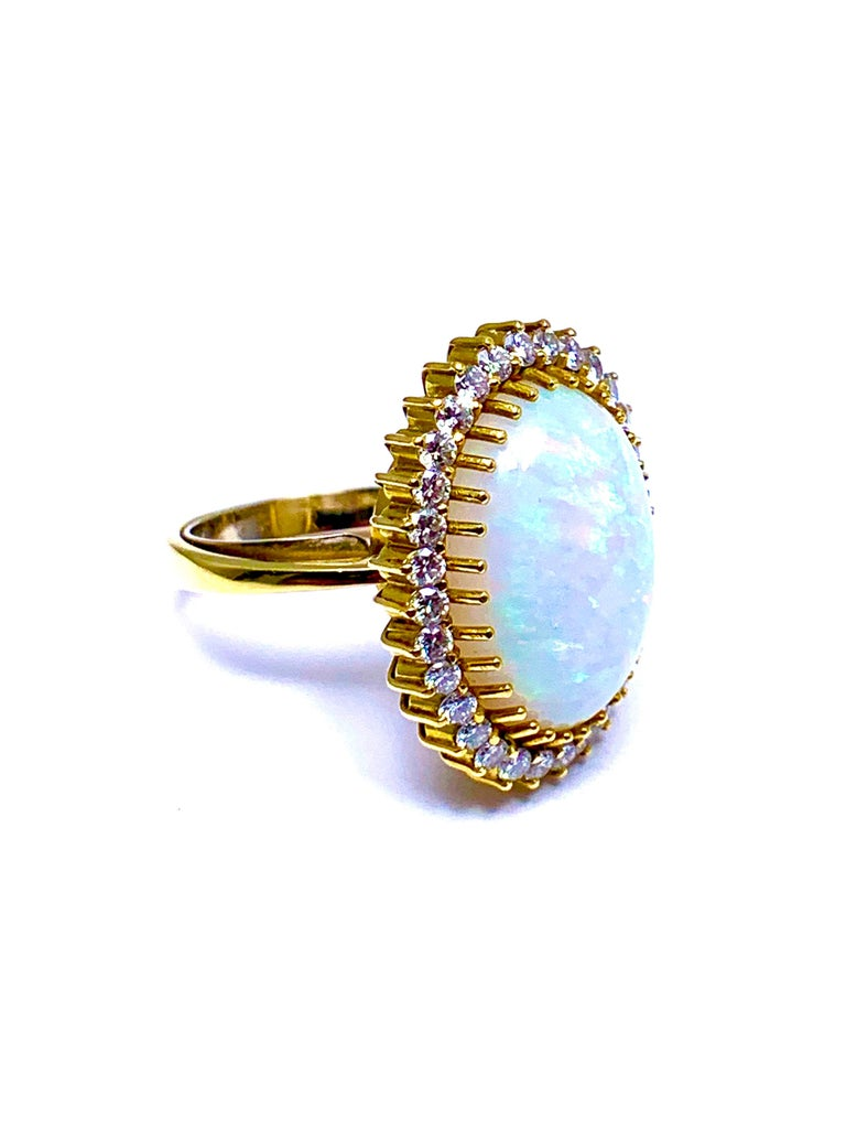 Women's or Men's 6.16 Carat Oval Cabochon Opal and Diamond 18 Karat Cocktail Ring For Sale