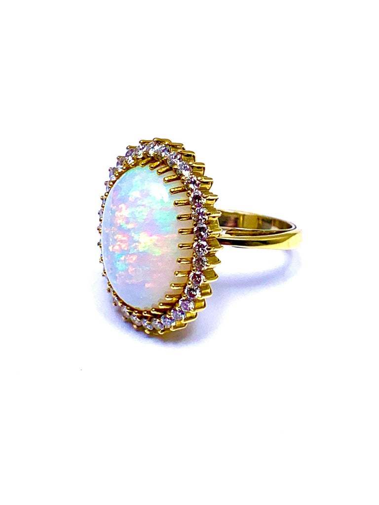 6.16 Carat Oval Cabochon Opal and Diamond 18 Karat Cocktail Ring For Sale 1
