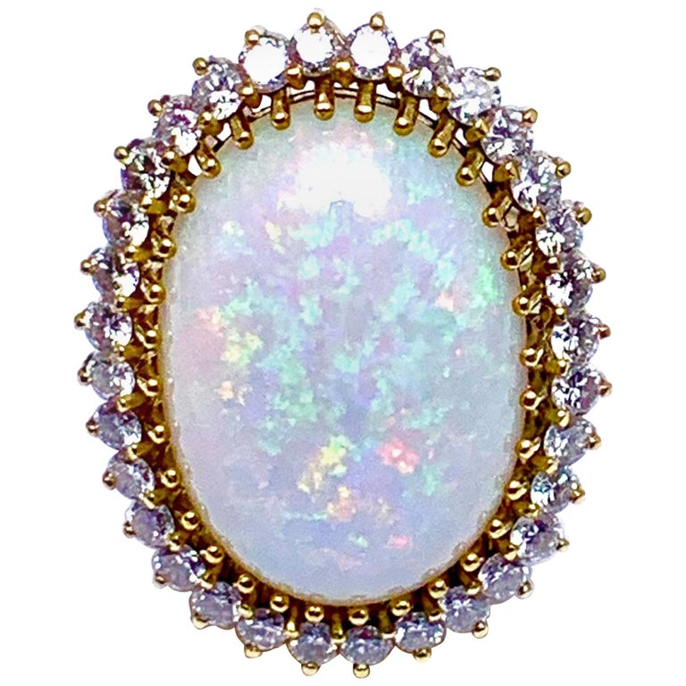 6.16 Carat Oval Cabochon Opal and Diamond 18 Karat Cocktail Ring For Sale