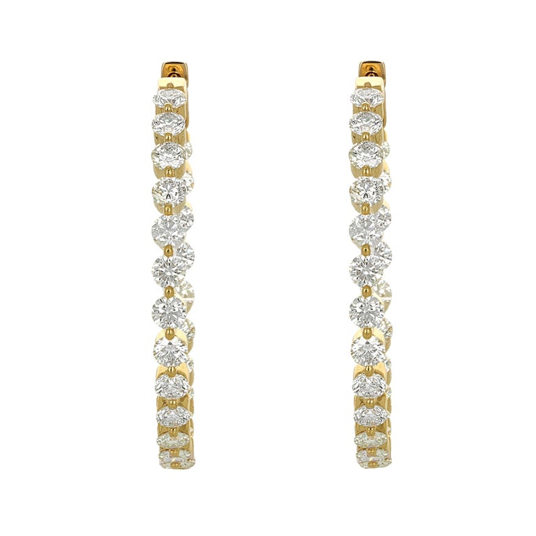 18 karat yellow gold diamond hoop earrings. There are 48 round brilliant diamonds weighing a total carat weight of 6.18 carats. The diamonds are H/I color, VS/SI clarity.