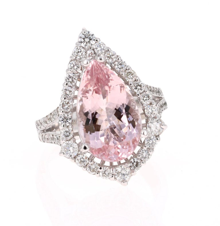 Dive into a gorgeous and unique Pink Morganite and Diamond Ring that can be your new Engagement Ring!   This Morganite ring has a gorgeous 5.16 Carat Pear Cut Pink Morganite and is surrounded by 52 Round Cut Diamonds that weigh 1.02 Carats. The