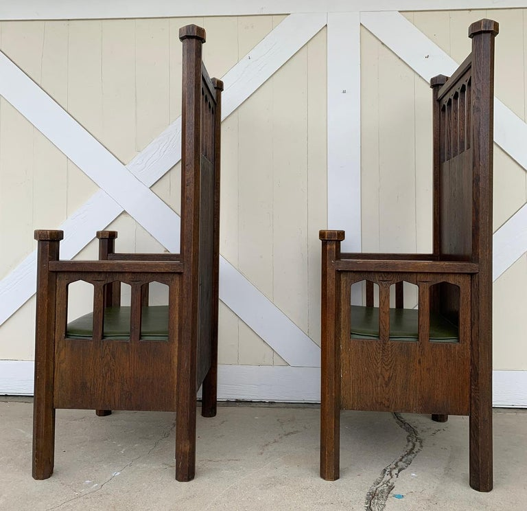 Extra tall arts and crafts armchairs from the late 1800s or early 1900s, build in solid wood, beautiful faceted pillars and finials, upholstered in green vinyl.  The chairs are solid, heavy and extremelly well built.  Measurements; 62 inches
