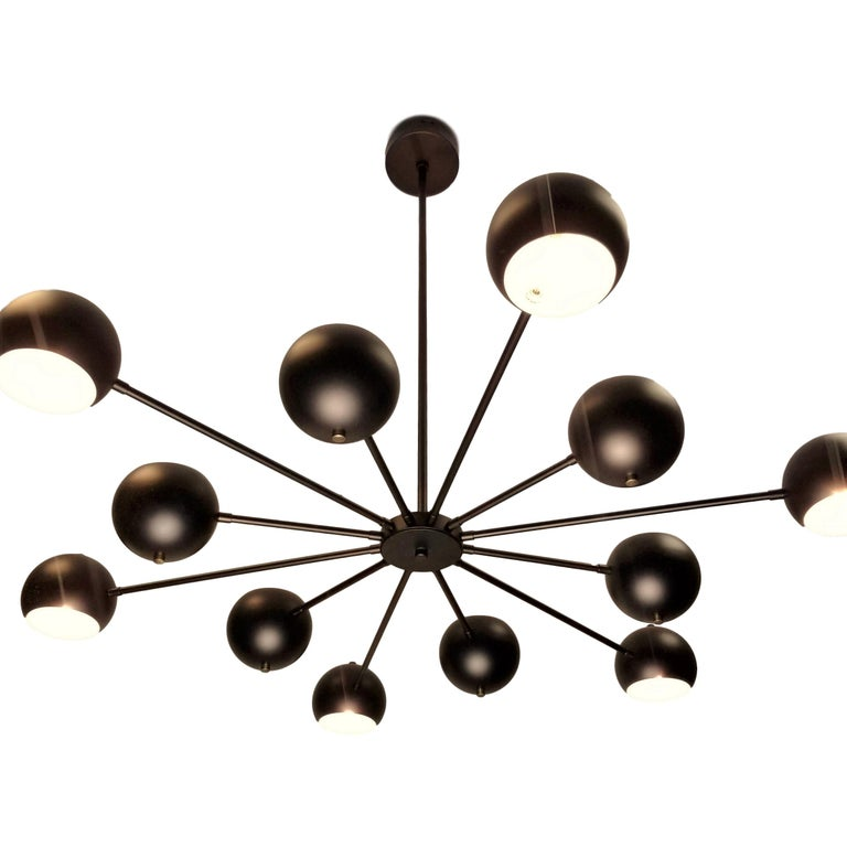 Introducing the Supernova chandelier-- a dynamic, lively design by Blueprint Lighting, 2019. Supernova is constructed with a brass frame with spun aluminium orbs; shown in our hand finished oil-rubbed bronze with natural brass button finials. This