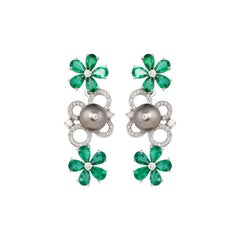 6.214 Carat Emerald Earring in 18 Karat White Gold with Diamonds and Pearls
