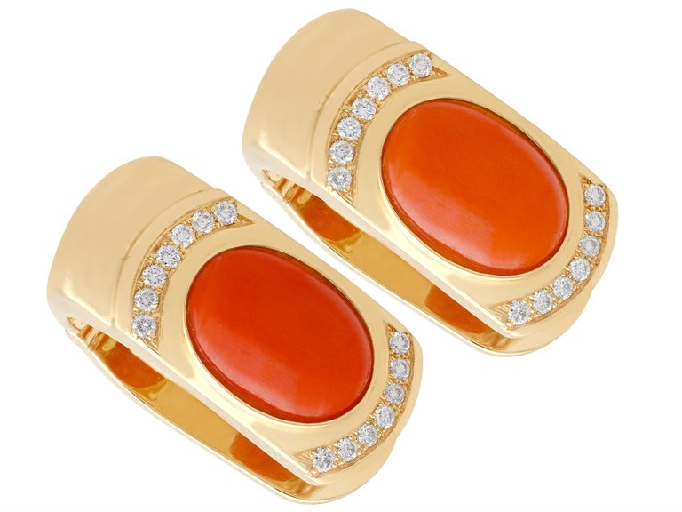 A stunning, fine and impressive pair of vintage 1970's 6.22 carat red coral and 0.70 carat diamond, 14 karat yellow gold earrings; part of our diverse vintage jewellery and estate jewelry collections.  These stunning, fine and impressive vintage