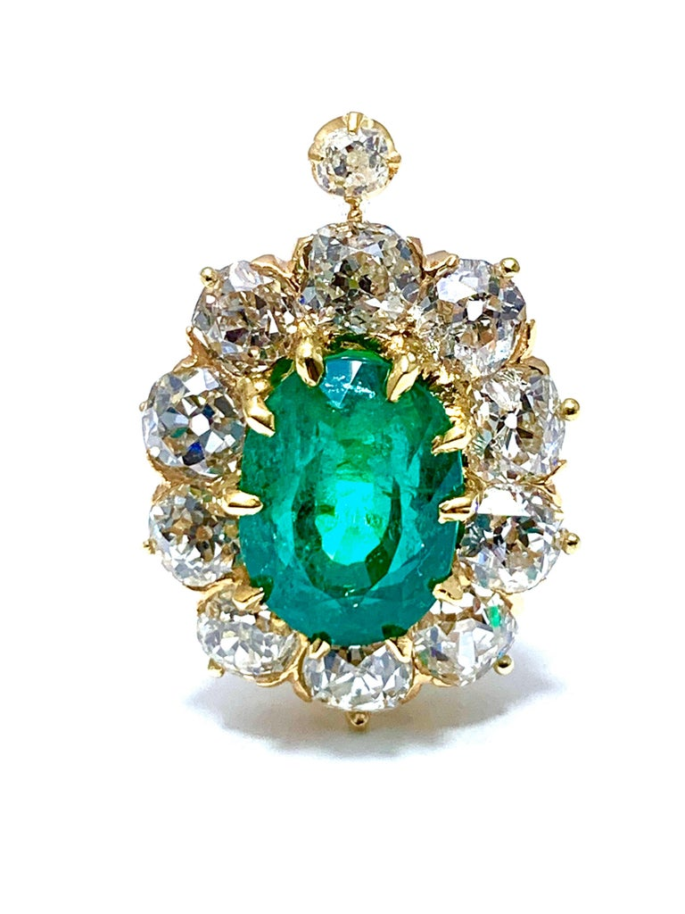 An absolutely stunning pair of natural Colombian emerald and old European cut diamond clip earrings, set in 18k yellow gold. The emeralds have a combined weight of 6.25cts, and an AGL report stating that they are natural, Colombian origin, with