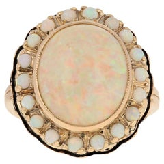 6.29 Carat Oval Cabochon Cut Opal Vintage Ring, 14 Karat Yellow Gold Halo