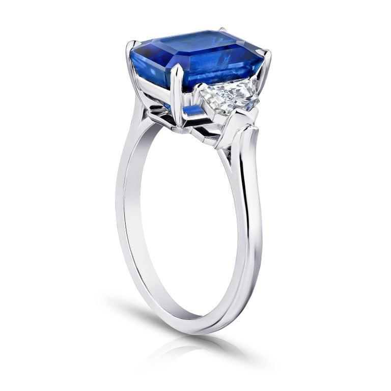 6.30 carat emerald cut blue sapphire with epaulet diamonds .95 carats set in a platinum ring.