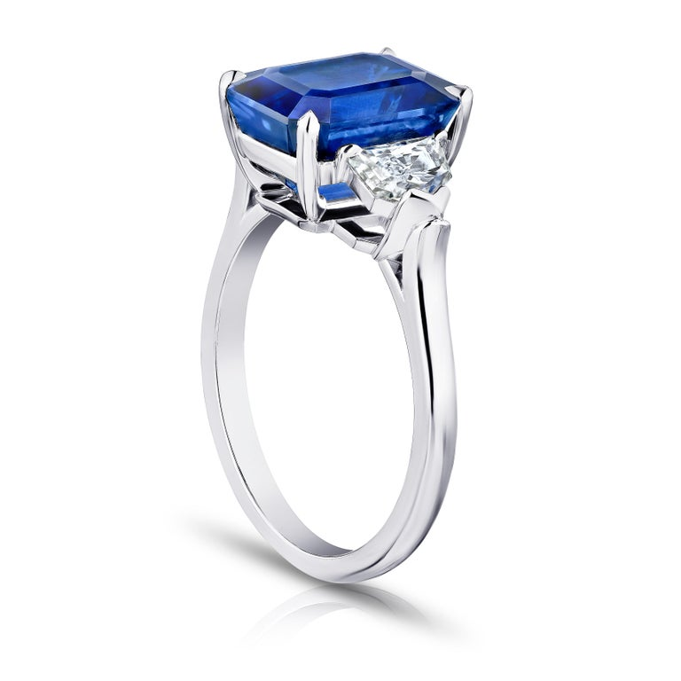 6.30 carat emerald cut blue sapphire with epaulet diamonds .95 carats set in a platinum ring.