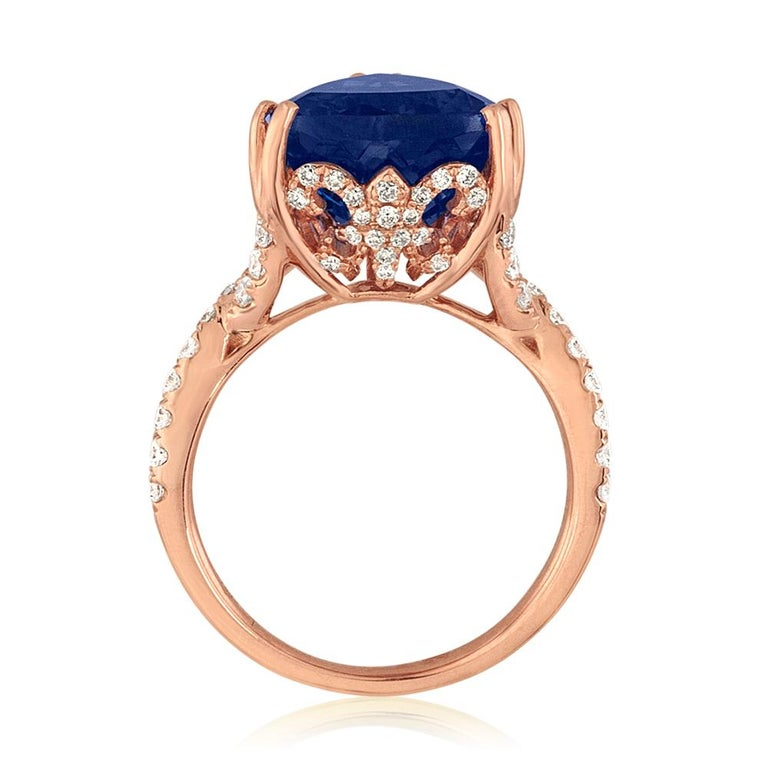 Very Unusual Tanzanite Trillion Cut Ring. The ring is 18K Rose Gold. There are 0.84 Carats in Diamonds G/H SI. The Tanzanite is 6.34 Carats Trillion Cut. The ring is a size 6.5, sizable. The ring weighs 6.7 grams.