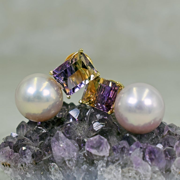 Beautiful, contemporary 14k yellow gold stud earrings featuring two fantasy, emerald cut Ametrine gemstones, totaling 6.36 carats, with 13.5mm pinkish purple Freshwater Pearl drops. Stud earrings are 0.94 inches or 24mm in length. Gorgeous and