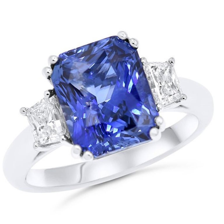 18K White Gold Sapphire and diamond engagement ring, features 6.36 Carat Radiant cut sapphire and 0.75 carats of trapezoids.  G-H in color SI in clarity.