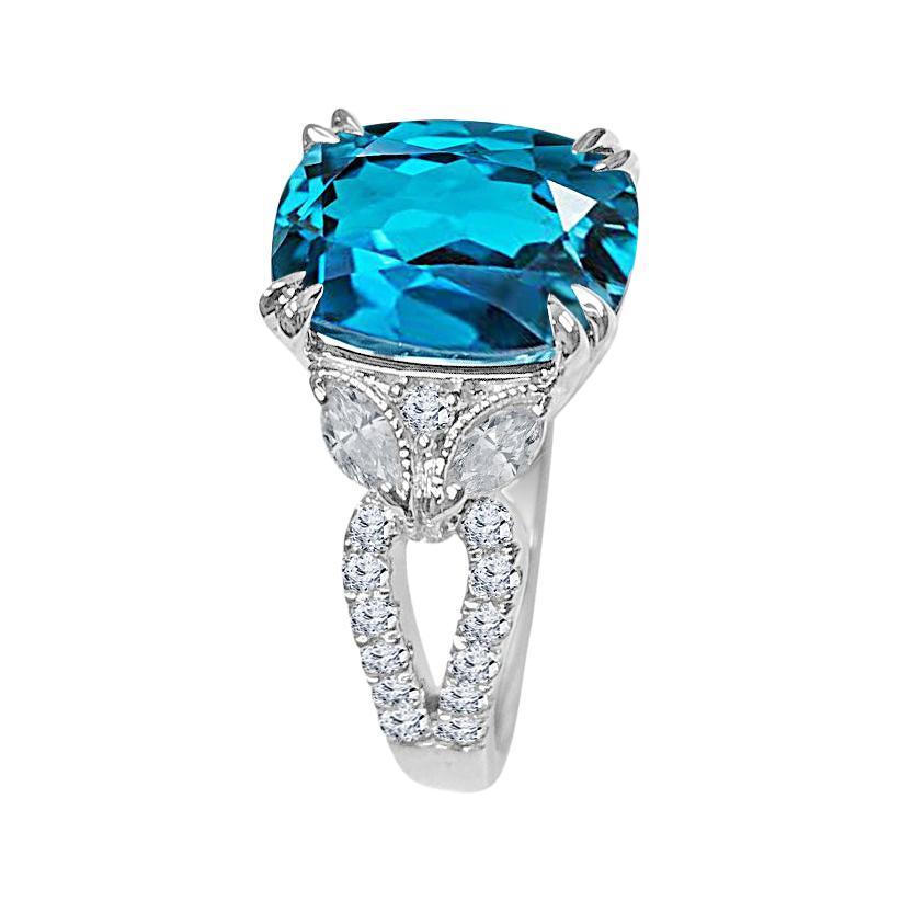 6.37 Carat Oval Cut London Blue Topaz and 0.78 Carat Diamond Ring