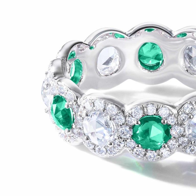 The Elements Ring embodies the light and delicate aesthetic that defines 64Facets' designs. Our classic Scallop band is rendered even more spectacular with the addition of radiant rose-cut emeralds with alternating rose-cut diamonds and delicately