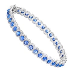 64 Facets 6.25 Carat Sapphire and 1.75 Carat Diamond Bangle in 18 Karat Gold