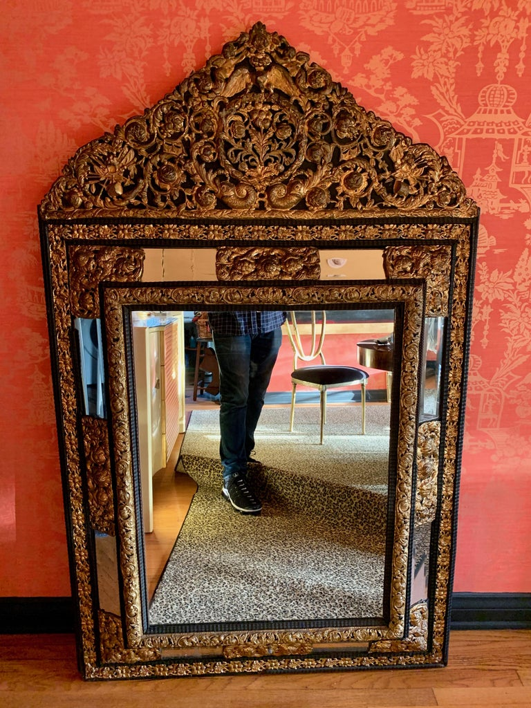 Baroque French Ebony Repousse Brass Mirror with Beveled Glass For Sale