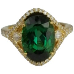 6.41 Carat Oval Cut Exotic Green Tourmaline and Diamond Ring in 18 Karat Gold