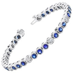 6.42 Carat Blue Sapphire and Diamond Bezel Set 18 Karat Gold Tennis Bracelet
