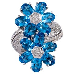 6.42 Carat Blue Topaz Flower Ring with Diamond Accents in White Gold
