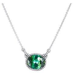 6.43 Carat Green Tourmaline and Diamond Pendant Halo Necklace in 18 karat Gold