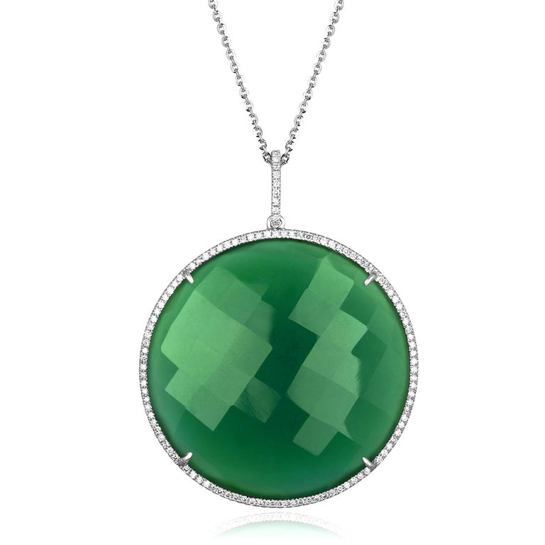 Beautiful Large Green Agate Pendant On A Chain. The pendant is 18K White Gold. The stone is Green Agate 64.54Ct There are 0.68 Ct in Diamonds H SI The pendant comes with a 18K White Gold Chain. The chain measures 16