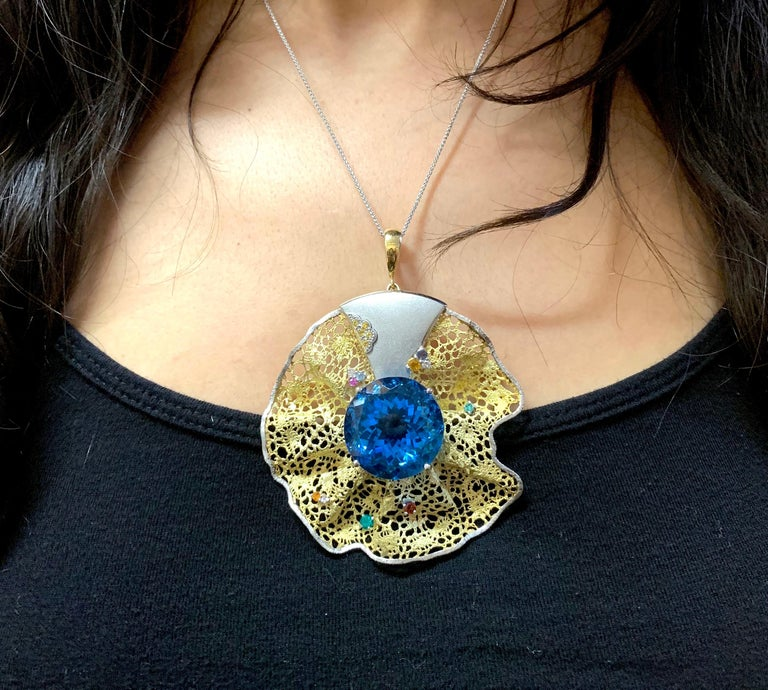 Contemporary 64.55 Carat Blue Topaz, Multi-Color Gemstone and Diamond Pendant or Brooch For Sale