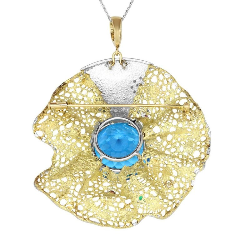 Material: 18k Two-tone Yellow & White Gold  Center Stone Details: 64.55 Carat Round Blue Topaz measuring 23 mm Gemstones: 13 Round Multicolor Gemstones at 0.50 Carats  Diamonds: 3 Round Diamonds at 0.10 Carats. SI Quality / H-I Color Chain: 22