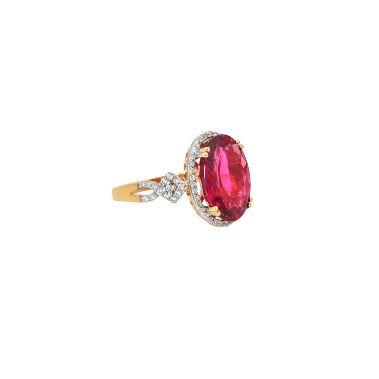 Contemporary 6.46 Carat Oval Shaped Rubelite Ring in 18 Karat Yellow Gold with Diamonds For Sale