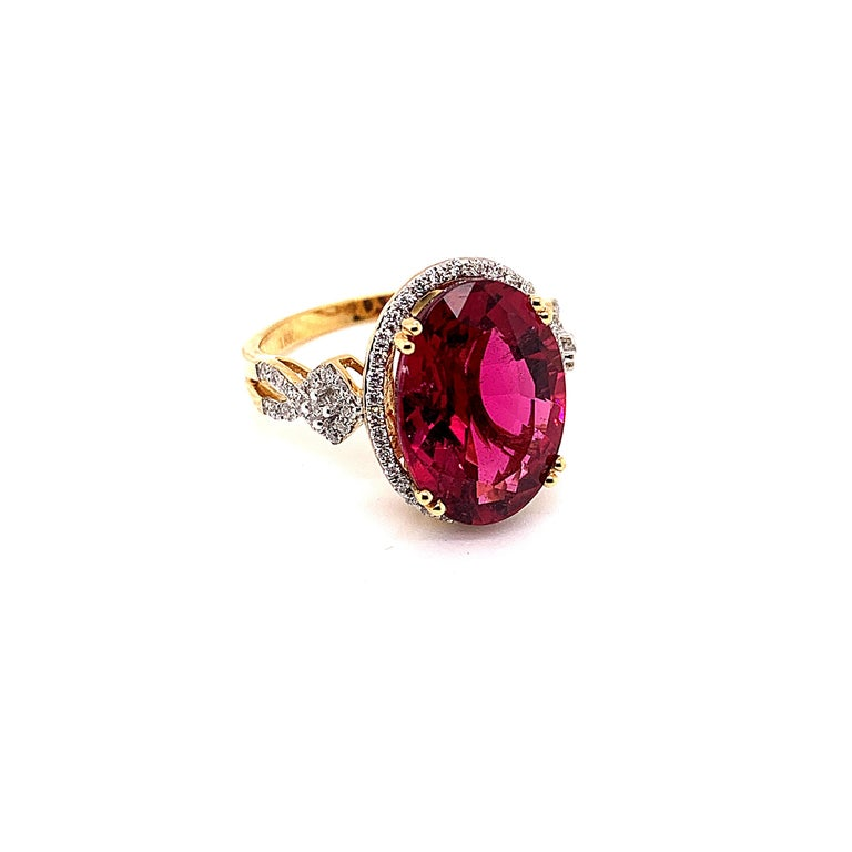 Oval Cut 6.46 Carat Oval Shaped Rubelite Ring in 18 Karat Yellow Gold with Diamonds For Sale