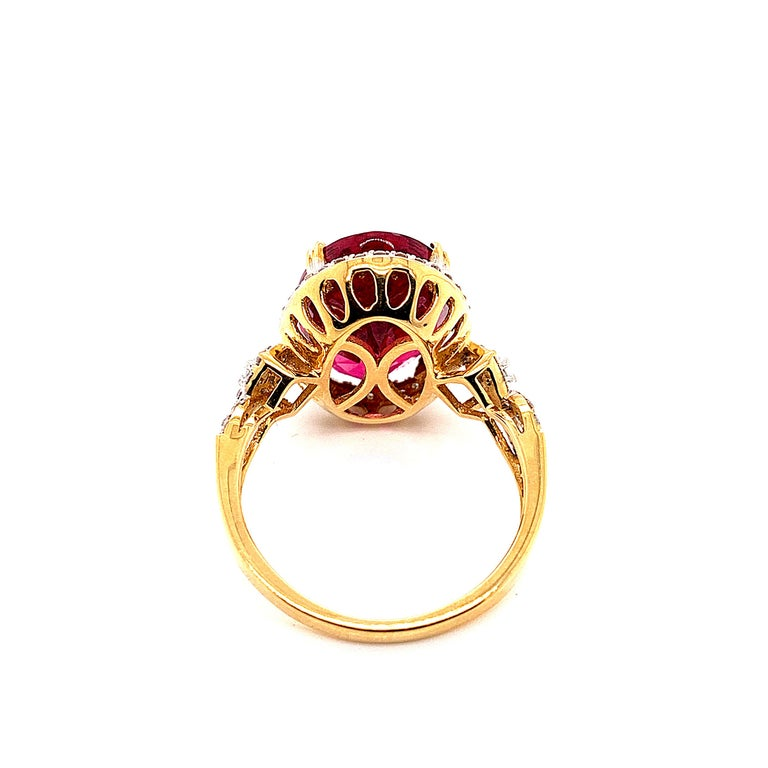 Women's 6.46 Carat Oval Shaped Rubelite Ring in 18 Karat Yellow Gold with Diamonds For Sale