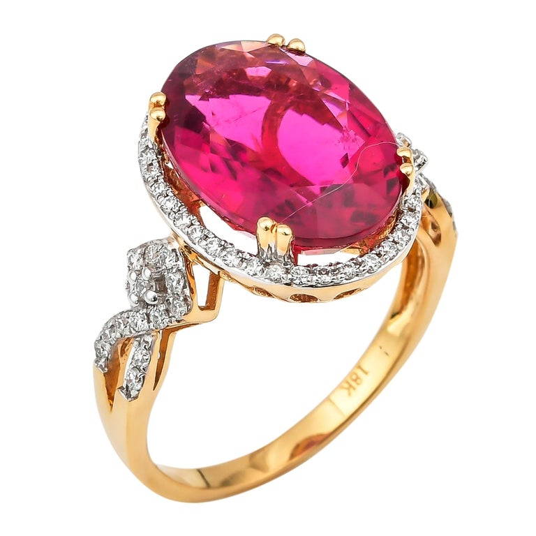 6.46 Carat Oval Shaped Rubelite Ring in 18 Karat Yellow Gold with Diamonds For Sale