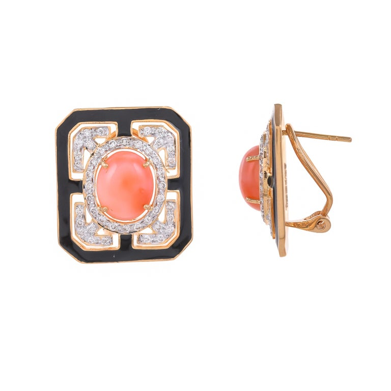 Modern and stylish this 18 karat earring features a bold, geometric shape set with the eccentric combination of 6.49 carats coral surrounded by sparkling white 0.94 carats diamonds and solid black enamel, highlights this statement yellow gold