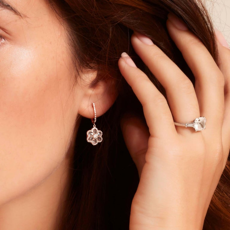 These stunning 1 carat Floral Diamond Drop Drop Earrings are the perfect set to add brightness to your style. Six oval shaped rose cut diamonds and one brilliant cut diamond are set in a creative floral arrangement, making it a versatile piece to