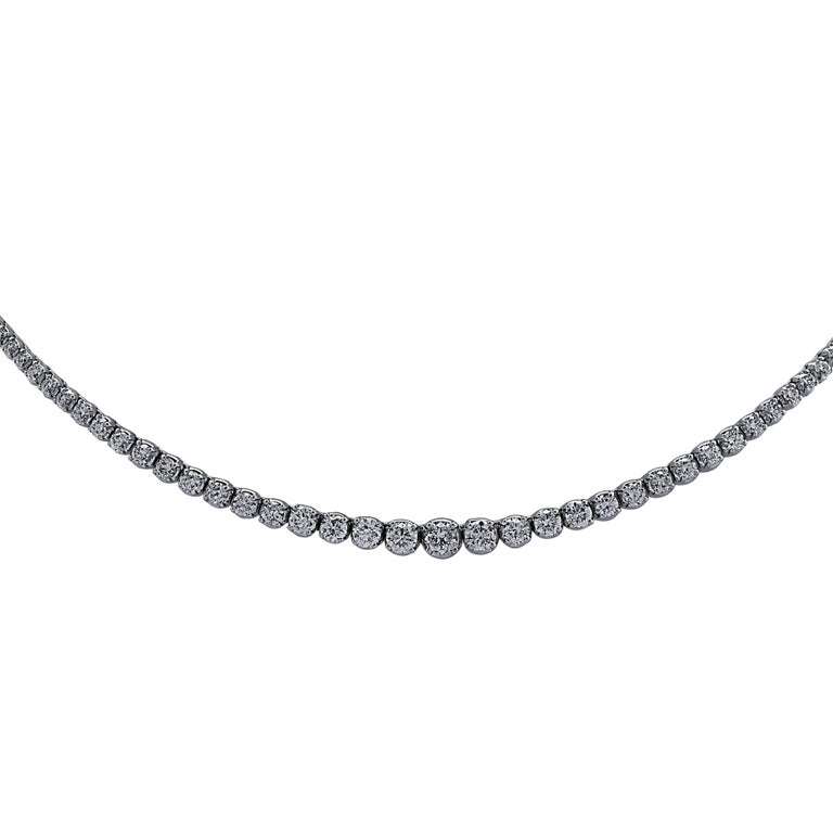 Exquisite diamond necklace crafted in White Gold, showcasing 137 round brilliant cut diamonds weighing 6.5 carats total, G color, SI clarity. The diamonds are set in a seamless sea of eternity, creating a spectacular symphony of brilliance and fire.