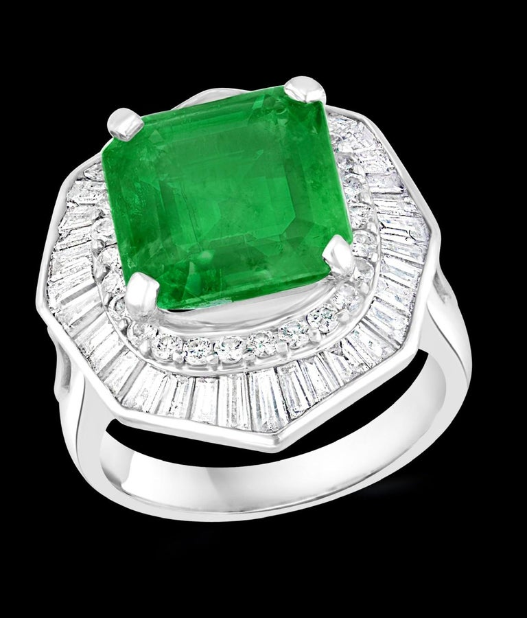 6.5 Carat Emerald Cut Colombian Emerald & 2.4 Carat Diamond Ring Platinum Size 5 Colombian emeralds are very precious , Very Difficult to find and getting more more difficult to find. A classic, Cocktail ring  6.5 Carat  Colombian Emerald