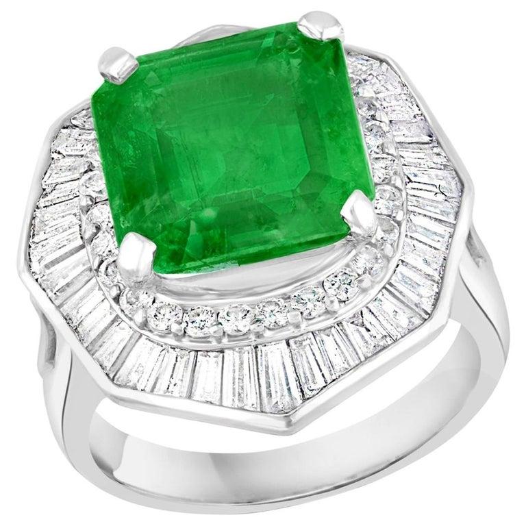 6.5 Carat Emerald Cut Colombian Emerald and 2.4 Carat Diamond Ring Platinum For Sale