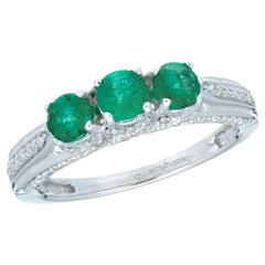 .65 Carat Emerald Diamond White Gold Three-Stone Ring