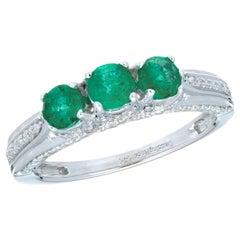 .65 Carat Emerald Diamond White Gold Three-Stone Ring