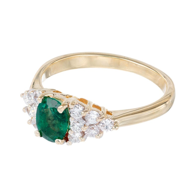 Oval Cut .65 Carat Oval Emerald Diamond Gold Cluster Engagement Ring For Sale