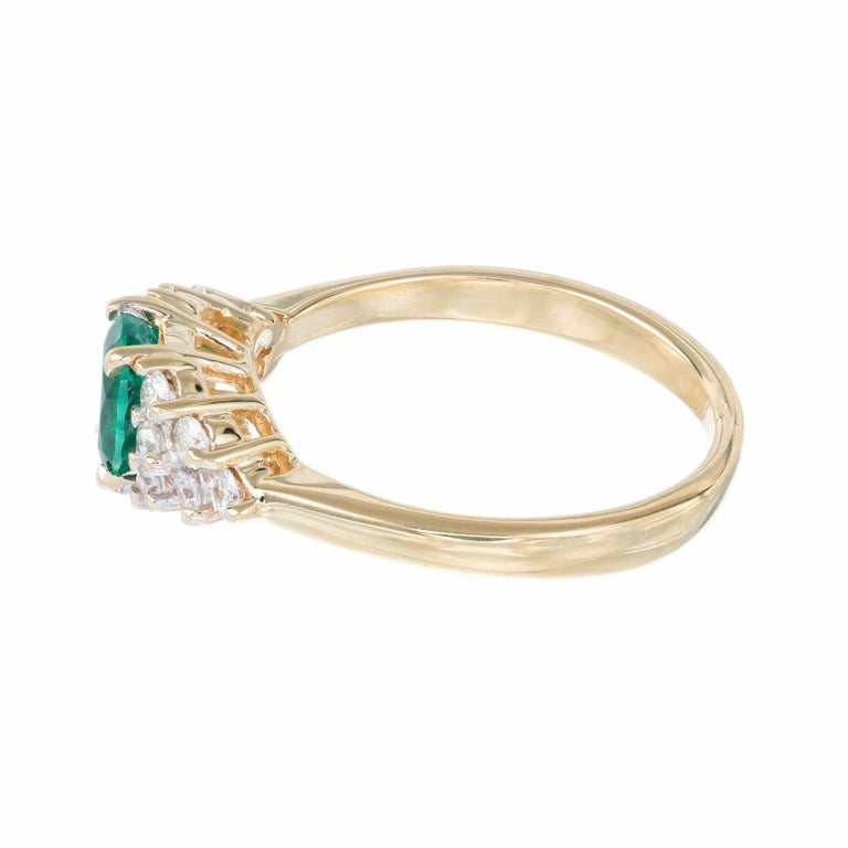 .65 Carat Oval Emerald Diamond Gold Cluster Engagement Ring In Good Condition For Sale In Stamford, CT