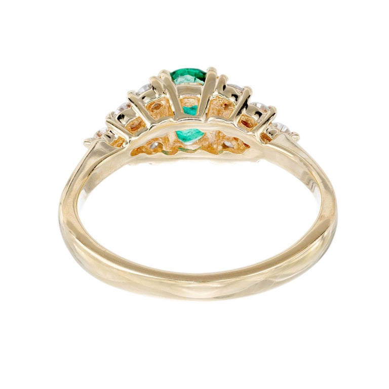 Women's .65 Carat Oval Emerald Diamond Gold Cluster Engagement Ring For Sale