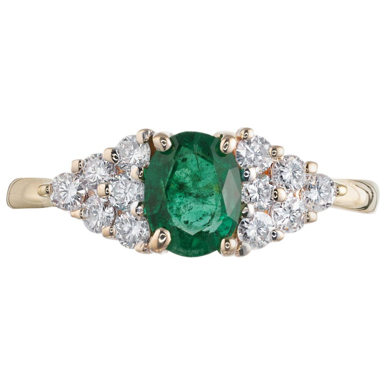 .65 Carat Oval Emerald Diamond Gold Cluster Engagement Ring For Sale