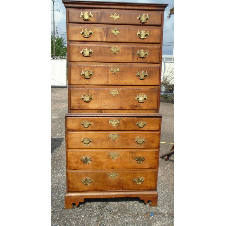 Nine-drawers chest-on-chest  A graduated piece with 9 drawers.  Brass pulls. Dove-tailed joints.  Measures: 36.5