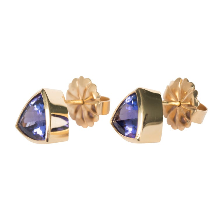 Item Details:  Length: .55 inches  Metal Type: 18 karat Yellow Gold  Weight: 5.5 grams  Color Stone Details:  Type: Tanzanite Shape: Triangular Brilliant  Carat Weight: 6.50 carat, total weight.  Finger to Top of Stone Measurement: 5.10mm