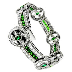 6.54 Carat Tsavorite and Emerald Diamond Bracelet