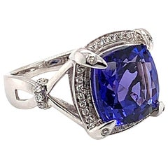 6.549 Carat Cushion Shaped Tanzanite Ring in 18 Karat White Gold with Diamonds