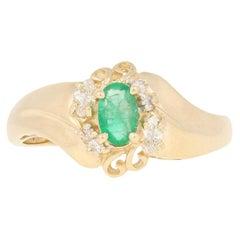 .65ctw Oval Cut Emerald & Diamond Ring, 14k Yellow Gold Bypass