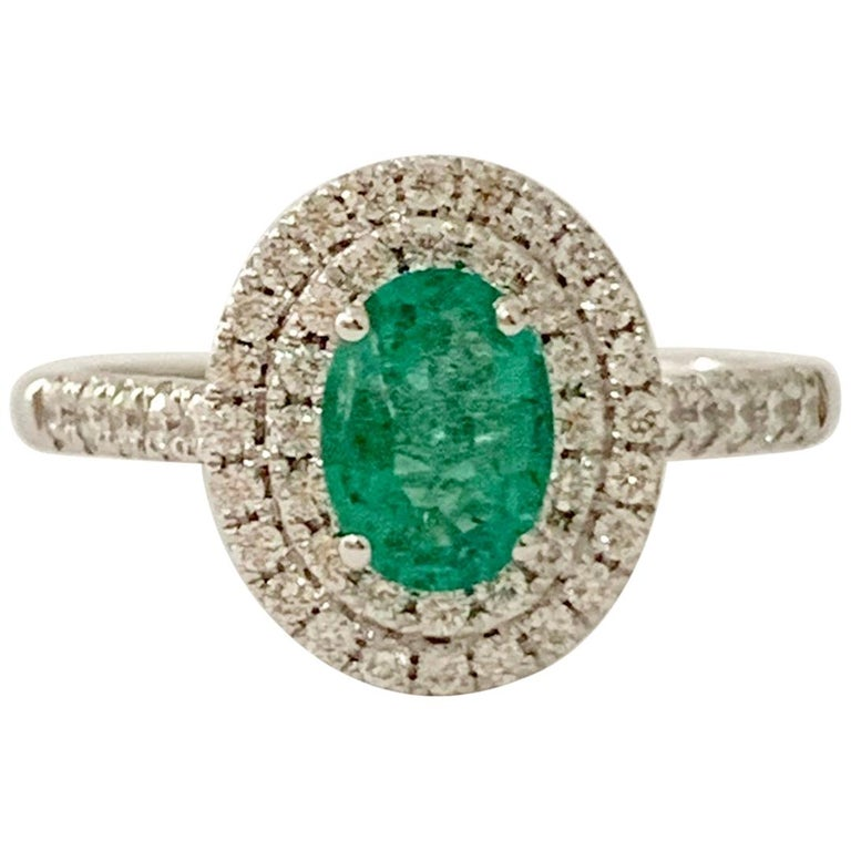 .66 Carat AAAA Oval Emerald Set in Double Diamond Halo Ring in 18ct White Gold For Sale
