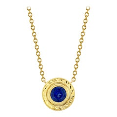 .66 Carat Royal Blue Sapphire 18 Karat Yellow Gold Hand Engraved Necklace