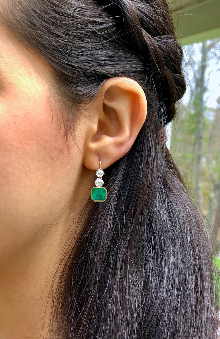 The Gorgeous 5 Carat finest Colombian Emerald Emerald Cut are set in these remarkable 1.60 carat Old European cut diamonds. This exquisite pair of earrings are beautifully crafted with 18K yellow and white gold, feature four old European cut